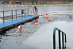 Christmas Day London 2010   Serpentine Lido  Swimming Club  annual 100 metre Peter Pan Cup Race cancelled due to ice. Uk Some brave swimmers took a dip to keep the one hundred year old tradition alive. The Serpentine Swimming Club is one of the oldest swimming clubs in the world founded in 1864.
