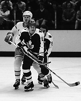 Toronto Maple Leafs vs California Seals 1975 Inge Hammarstrom and Seals John Stewart. (photo/Ron Riesterer)