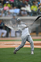 A fan of the Columbia Fireflies participates in a between-innings game of hitting water balloons during a game against the Lexington Legends on Sunday, April 23, 2017, at Spirit Communications Park in Columbia, South Carolina. Lexington won, 4-2. (Tom Priddy/Four Seam Images)