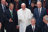 Pope Francis (C) walks with US Speaker of the House, Republican from Ohio John Boehner (L) and US Vice President Joe Biden (R), after deliver an address to a joint session of Congress, in Statuary Hall at the U.S. Capitol in Washington DC, USA, 24 September 2015. Pope Francis is on a five-day trip to the USA, which includes stops in Washington DC, New York and Philadelphia, after a three-day stay in Cuba. Pope Francis added the Cuba visit after helping broker a historic rapprochement between Washington and Havana that ended a diplomatic freeze of more than 50 years.<br /> Credit: Michael Reynolds / Pool via CNP