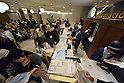 May 22, 2012, Tokyo, Japan - Visitors get information of the Tokyo Skytree, the worlds tallest self-standing terrestrial broadcast tower at 634 meters, which opens to the public in downtown Tokyo on Tuesday, May 22, 2012...Despite the foul weather, some 8,000 visitors turned out on the first day to see the limited but 360-degree views of the nations capital from two observation decks. On the opening day alone, the operator expected about 200,000 visitors to Tokyo Skytree Town commercial complex, which consists of the tower, a 312-tenant shopping and restaurant zone called &quot;Tokyo Solamachi,&quot; an office building zone, an aquarium and a planetarium. (Photo by Natsuki Sakai/AFLO) AYF -mis-.