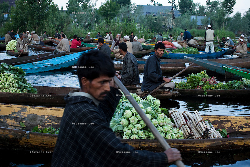 Travel photos of the sceneries in and around Kashmir, Dal Lake, and its Vegetable Boat Market. .*Pre-season Jeep road trip from Delhi to Amritsar, Srinagar, Kargil, Lamayuru, Leh, Khardung La, Tso Moriri and back to Delhi in May 2010. Photo by Suzanne Lee