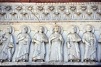 Late medieval relief sculptures of the typanuim of the main door depicting St Mary and the Apostles , the Cattedrale di San Martino,  Duomo of Lucca, Tunscany, Italy,