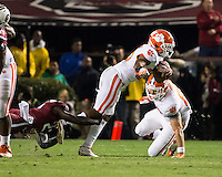 The tenth ranked South Carolina Gamecocks host the 6th ranked Clemson Tigers at Williams-Brice Stadium in Columbia, South Carolina.  USC won 31-17 for their fifth straight win over Clemson.  Clemson Tigers running back Roderick McDowell (25), South Carolina Gamecocks cornerback Victor Hampton (27)