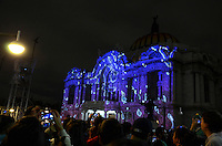 Mexico City, November 10, 2013. A man takes pictures with his mobile while thousands of people gathered at the Palace of Fine Arts in Mexico City, to witness the first International Festival of Lights Mexico 2013.  VIEWpress/Miguel Angel Pantaleon