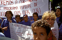 Students from several schools wave banners and listen to speakers during a demonstration protesting inadequate educational funding in Rio de Janeiro. Public school teachers in Brazil often make only the minimum wage of $120 per month. Most must take second and third jobs to survive in one of the Western Hemisphere's most expensive cities.