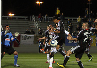 Andy Najar(14) and Branden Barklage(24) of D.C. United in front of Faryd Mondragon(1) of the Philadelphia Union during a play-in game for the US Open Cup tournament at Maryland Sportsplex, in Boyds, Maryland on April 6 2011. D.C. United won 3-2 after overtime penalty kicks.