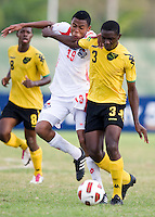 Kemo Wallace (3) of Jamaica fights for the ball with Alfredo Stephens (19) of Panama during the third place game of the CONCACAF Men's Under 17 Championship at Catherine Hall Stadium in Montego Bay, Jamaica. Panama defeated Jamaica, 1-0.