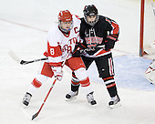 Holly Lorms (BU - 8), Lori Antflick (NU - 77) - The Northeastern University Huskies tied Boston University Terriers 3-3 in the 2011 Beanpot consolation game on Tuesday, February 15, 2011, at Conte Forum in Chestnut Hill, Massachusetts.