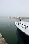 Bow of boat in dense fog on Lake Michigan, Leland Historic District (Fishtown), Michigan, USA