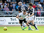 Dundee v St Johnstone...15.08.15  SPFL   Dens Park, Dundee<br /> Graham Cummins is brought down by Gary Harkins and Julen ExtaBeguren<br /> Picture by Graeme Hart.<br /> Copyright Perthshire Picture Agency<br /> Tel: 01738 623350  Mobile: 07990 594431