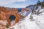 Bryce Canyon National Park, Utah; views of Natural Bridge with snow in winter, from Natural Bridge turnout, elevation 8627 feet