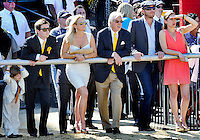 Team Bodemeister at the rail watching a race on the undercard before the Preakness on Preakness Day at Pimlico Race Course on May 19, 2012. Bode Miller, 2nd from right, for whom Bode Baffert was named attended the Preakness festivities with Bob and Jill Baffert.