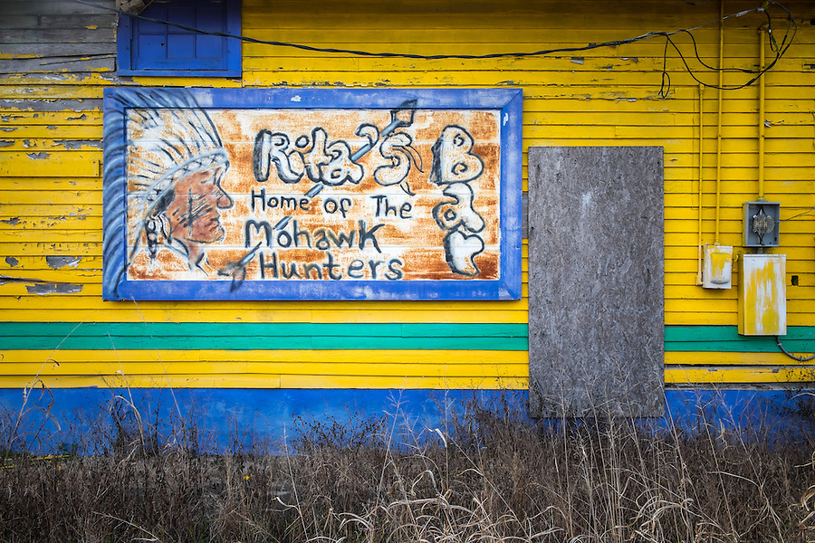 NEW ORLEANS - CIRCA FEBRUARY 2014: View of a of the side wall of an abandoned store in Algiers Point, a popular community within the city of New Orleans in Louisiana.