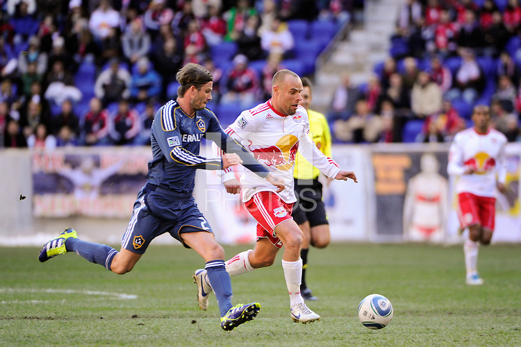 Joel Lindpere (20) of the New York Red Bulls and David Beckham (23) of the Los Angeles Galaxy during the 1st leg of the Major League Soccer (MLS) Western Conference Semifinals at Red Bull Arena in Harrison, NJ, on October 30, 2011.