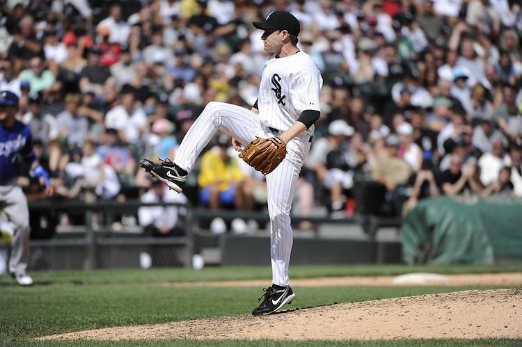 CHICAGO - AUGUST 14:  Jason Frason #58 of the Chicago White Sox pitches against the Kansas City Royals on August 14, 2011 at U.S. Cellular Field in Chicago, Illinois.  The White Sox defeated the Royals 6-2.  (Photo by Ron Vesely)   Subject: Jason Frasor