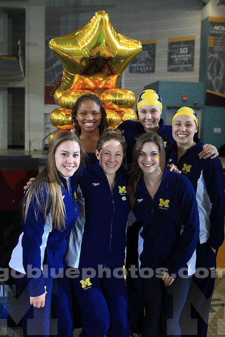 The University of Michigan women's swimming and diving team compete on the first day of competition at the 2014 Women's Big Ten Championships. Minneapolis, MN at the University of Minnesota Aquatics Center. February 22, 2014