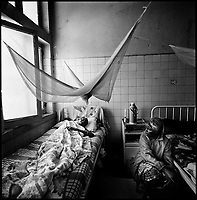 Huambo, Angola, May, 24, 2006.Rufinu Chivela, 31, with his mother Veronica Vicumba, 60. More than 300 TB patients live in Huambo State Sanatorium, hundreds more are outside patients. TB is endemic in the region, fueled by poverty, malnutrition, inadequate hygiene and the rapid spreading of HIV/AIDS since the end of the civil war in 2002.