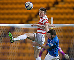 St Johnstone v Hamilton Accies...04.01.15   SPFL<br /> Michael Devlin gets above James McFadden<br /> Picture by Graeme Hart.<br /> Copyright Perthshire Picture Agency<br /> Tel: 01738 623350  Mobile: 07990 594431