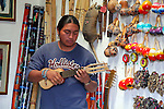 South America, Ecuador, Peguche. A local Andean musician demonstrates various traditioal instruments.