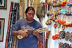 South America, Ecuador, Peguche. A local Andean musician demonstrates various traditioal instruments.