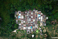Older buildings surrounded by a forest in the area of Wuming near Nanning. /Felix Features