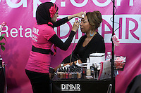 Dinair Airbrush stlyist, applies makeup on woman, at the Makeup Show NYC, May 15 2011.