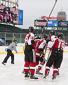 John Stevens (NU - 18), Matt Benning (NU - 5), Mike Szmatula (NU - 19) - The Northeastern University Huskies defeated the University of Massachusetts Lowell River Hawks 4-1 (EN) on Saturday, January 11, 2014, at Fenway Park in Boston, Massachusetts.