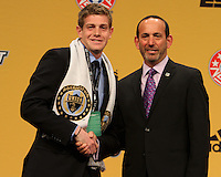 Zac McMath of the University of Maryland with commissioner Don Garberat the 2011 MLS Superdraft, in Baltimore, Maryland on January 13, 2010.