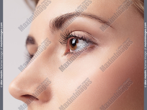Closeup of a young woman eye with long eyelashes