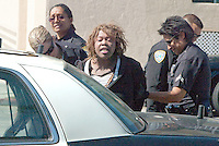 LAPD Officers arrest a woman at Bay Street  who allegedly a stole a Buick LeSabre  on Friday, March 25, 2011. Police found the car via LoJack