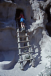 woman on ladder at Bandalier National Monument