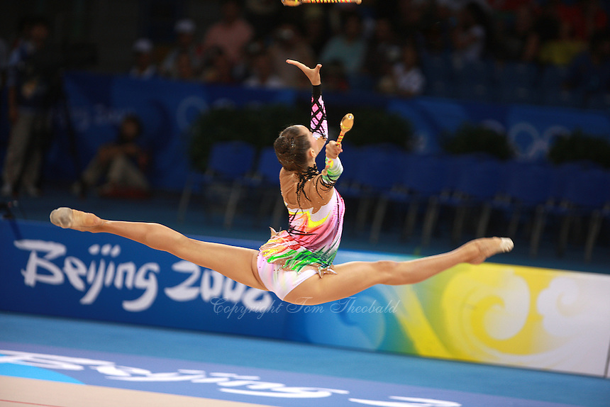 August 22, 2008; Beijing, China; Rhythmic gymnast Liubov Charkashina of Belarus performs with clubs on way to placing 15th in qualifying round at 2008 Beijing Olympics..(©) Copyright 2008 Tom Theobald