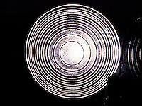 FRESNEL LENS FROM FOCUSING SPOtLIGHT<br /> Concentric stepped zones greatly increase light transmittance