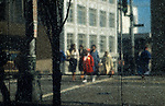 Street scene reflecting off side of building with tree and marble reflection with people along streets Seattle Washington State USA