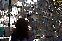 A woman takes pictures of letters for the victims of the last dictatorship during a demonstration led by the 'Madres de Plaza de Mayo'  to commemorate the 37th anniversary of the coup of 1976, at Plaza de Mayo square in Buenos Aires on March 24, 2013. Photo by Juan Gabriel Lopera / VIEWpress.