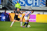 VOETBAL: HEERENVEEN: Abe Lenstra Stadion, SC Heerenveen - Vitesse, 21-01-2012, Alexander Büttner (#5), Luciano Narsingh (#24), Eindstand 1-1, ©foto Martin de Jong