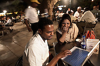 Lo'ay Ahmad (left) and Hind Ibrahim relaxing at Ozone, Khartoum's premier outdoor cafe, complete with Wi-Fi internet access and water vapour air conditioning.
