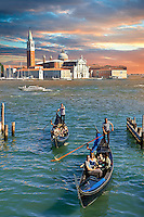 Gondolas at St Mark's Square with the island of San Giorgio Maggiore behind , with its church front designed by Andrea Palladio and begun in 1566.  Venice Italy