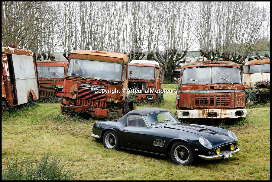 BNPS.co.uk (01202 558833)<br /> Pic: ArtcurialMotorcars/BNPS<br /> <br /> ***Please Use Full Bylne***<br /> <br /> Ferrari 250 GT California SWB.<br /> <br /> An incredible &pound;12 million treasure trove of classic cars has been discovered after spending 50 years languishing in storage on a farm.<br /> <br /> The 60 rusting motors, which include a vintage Ferrari California Spider, a Bugatti and a very rare Maserati, were found gathering dust and hidden under piles of newspapers in garages and outbuildings at a property in France.<br /> <br /> The 'once-in-a-lifetime' find has been compared to a major archaeological discovery, on a par with Tutankhamun's tomb.