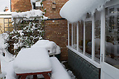 Winter snow beginning to melt and slide off the sloping roof.