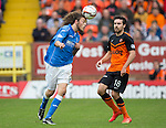 Dundee United v St Johnstone...27.09.14  SPFL<br /> Murray Davidson celars from Ryan Dow<br /> Picture by Graeme Hart.<br /> Copyright Perthshire Picture Agency<br /> Tel: 01738 623350  Mobile: 07990 594431