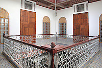 First floor central courtyard area with windows and doors to the living quarters off the balustraded balcony, in a typical Tetouan riad, a traditional muslim house built around a courtyard, built in Moorish style with strong Andalusian influences, next to the Great Mosque or Jamaa el Kebir in the Medina or old town of Tetouan, on the slopes of Jbel Dersa in the Rif mountains of Northern Morocco. Tetouan was of particular importance in the Islamic period from the 8th century, when it served as the main point of contact between Morocco and Andalusia. After the Reconquest, the town was rebuilt by Andalusian refugees who had been expelled by the Spanish. The medina of Tetouan dates to the 16th century and was declared a UNESCO World Heritage Site in 1997. Picture by Manuel Cohen