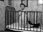 Product:Antique Brass Crib<br /> <br /> Wilkinsburg PA:  Helen Stewart getting ready for bed in her new brass crib - 1918