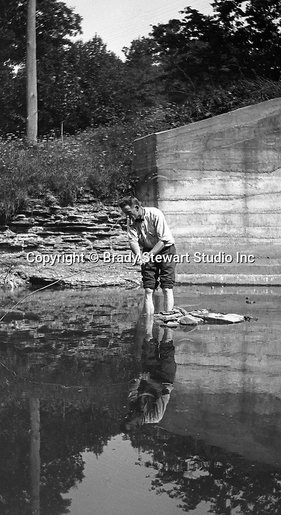 Erie PA:  Man fishing for lunch in a stream near Lake Erie - 1915