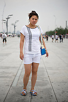 Nianyingnan, self-employed, age 26, poses for a portrait in Beijing. Response to 'What does China mean to you?': 'A country.'  Response to 'What is your role in China's future?': 'To make progress.'