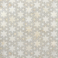 Reina, a natural stone waterjet mosaic shown in Cloud Nine and Ming Green polished, is part of the Miraflores Collection by Paul Schatz for New Ravenna Mosaics.<br />