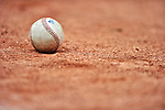 21 August 2010: A New York Penn League baseball lies on the gravel outside the dugout prior to a game between the Vermont Lake Monsters and the Brooklyn Cyclones at Centennial Field in Burlington, Vermont. The Cyclones defeated the Lake Monsters 8-7 in a 12-inning game that had to be resumed in Brooklyn on August 31 due to late inning rain. Mandatory Credit: Ed Wolfstein Photo
