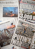 New York newspapers on Friday, July 18, 2014 report on the previous days alleged missile strike on Malaysian Flight 17 over the Ukraine. (© Richard B. Levine)