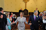 Newly married, the couple's joyous recessional.